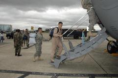 Airmen boarding C-17 aircraft